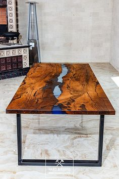 Loft wooden table for 8-10 persons for dinig or conference room. A large dining table in the River style of solid wood and epoxy resin with a blue tint. Table made of wooden slabs of Karpinus with a very beautiful texture and a natural, live edge. The table is covered with natural