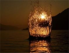 Water Splash In Front of Sunset