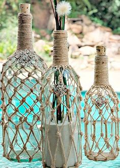 home decor wine bottle rope beachy ballard designs knockoff, crafts, repurposing upcycling (Whisky Bottle Gift) Glass Bottle Crafts - DIY Glass Bottle Ideas - Coastal Decor Grab some twine and a mix of wine and beer bottles so you can jump on the nautical Glass Bottle Crafts, Wine Bottle Art, Diy Bottle, Beer Bottles, Crafts With Bottles, Empty Liquor Bottles, Wrapped Wine Bottles, Decorate Wine Bottles, Twine Wine Bottles