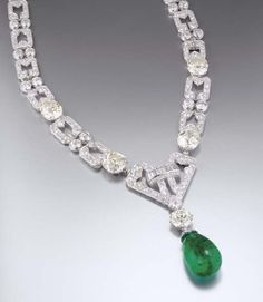 AN IMPRESSIVE ART DECO EMERALD AND DIAMOND NECKLACE, BY CHAUMET Designed as graduated openwork rectangular links with two-stone spacers set with four cushion-shaped diamond collets, the central openwork plaque suspending a circular-cut diamond and drop-shaped emerald pendant (may be worn as a bracelet) circa 1930, necklace 39.0 cm long, bracelet 19.0 cm long, with French assay marks for platinum and gold. By Chaumet, with maker's mark for Chaumet