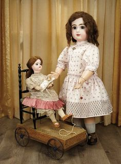 "Sanctuary: A Marquis Cataloged Auction of Antique Dolls - March 19, 2016: Delightful French Pull-Toy ""Little Girl Holding Her Doll"""