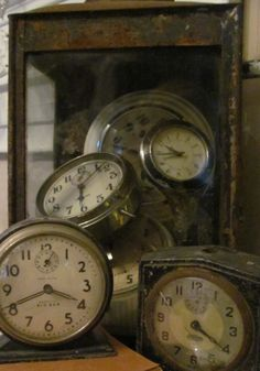Old clocks..I love them whether they are small and in the house on display or hanging in public. -kjk