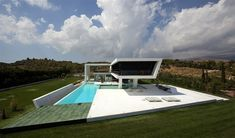 H3 House by 314 Architecture Studio. In Athens, Greece, 314 Architecture Studio completed this interesting futuristic residence. It was designed in order to give the sense of sailing,  speed and hovering over the water.