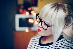 Blonde bangs and red lipstick.
