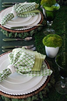 St. Patrick's Day tablescape by Home Is Where the Boat Is. Love the layered white dishes, the plaid napkins, and moss cups!