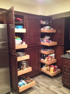 Pull out pantry shelves in kitchen cabinets by Woodwork Creations.