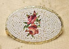 Vintage Schildkraut Handmade Petit Point Bead Lipstick Mirror Compact is such a wonderful piece that appears to have never been used.  The mirror and lipstick holder are connected by a hinge for eithe