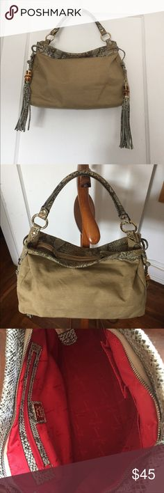🎊NEW YEAR'S SALE🎊 Italian snakeskin/canvas bag Jenrigo Italian snakeskin and beige canvas shoulder bag. Has red inner lining with a zippered pocket and two interior pockets. Has two bamboo and snakeskin tassels on the side. Shoulder strap has approximately 5-inch drop. In pretty good condition. Very lightweight and not heavy at all! Great for any chic woman! Really great bag for spring/summer/fall!! jenrigo Bags Shoulder Bags