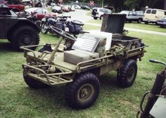 """The U.S. Military M274 Truck, Platform, Utility, 1/2 Ton, 4X4 or """"Carrier, Light Weapons, Infantry, 1/2 ton, 4x4"""" aka """"Mule,"""" """"Military Mule,"""" or """"Mechanical Mule"""" is a 4-wheel drive, gasoline-powered truck/tractor type vehicle that can carry up to a 1/2 ton off-road. It was introduced in 1956 and used until the 1980s."""