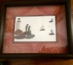 Pebble and sea glass art.  Lighthouse by the sea. One of a kind. Would make a nice Christmas gift.