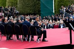 President Obama gives a 'thumbs-up' to a group of World War II veterans sitting behind him on stage following his speech at the 65th anniversary of the D-Day invasion in Normandy, France, June 6, 2009