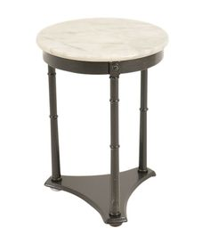 Side Table Option  DIMENSIONS: 18 X 18 X 25   Oswald Side Table at Found Vintage Rentals. Round white marble top side table.  The three legs running down to its base are simply decorated.