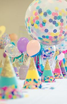 A pastel Princess Dress Up Birthday Party full of confetti baloons and party hats - Inspired By This