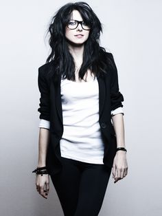 this is me. messy dark hair, glasses, blazer, jeans, leather strap bracelets....