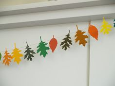 Easy Fall Craft To do: Make A Colorful Autumn Leaf Garland...using paint chip swatches. and a punch. Sweet