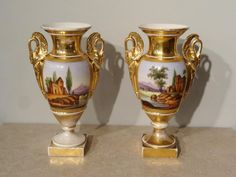 """Pair of porcelain baluster vases """"Vieux Paris"""" with polychrome and gold decoration. There are rustic decorations on the paws and the handle Vases, Old Paris, Plastic Items, Porcelain Vase, Urn, Diamond Pendant, Pedestal, Round Diamonds, Rustic Decor"""