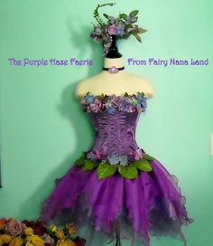 Passionate Purple organzas in the faerie skirt coordinate beautifully with the brocade corset lavishly embellished with romantic garlands of foliage and flowers (both top and bottom.....) A gorgeous beaded Faerie Crown with the same flowers and foliage will adjust to any head size with ribbon ties in the back.