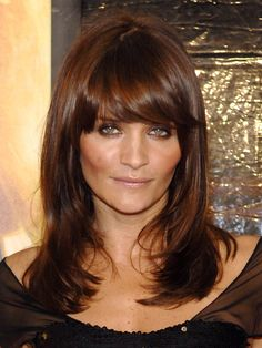 Perfectly glossy chocolate brown hair color... with hair like that, Helena needs to smile!