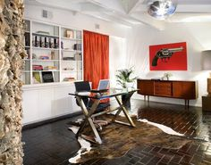 brilliant mix of old and new... wow. not a fan of animal hide or brick floors but still.