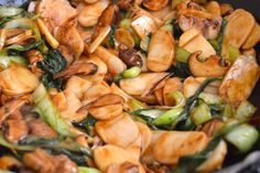 STIR-FRIED STICKY RICE CAKES (Nian Gao) Recipe Main Dishes with pork shoulder, corn starch, soy sauce, oil, rice cakes, napa cabbage, dried shiitake mushrooms, sliced mushrooms, leeks, garlic, oil, Shaoxing wine, dark soy sauce, light soy sauce, oyster sauce, ground white pepper, salt, sugar