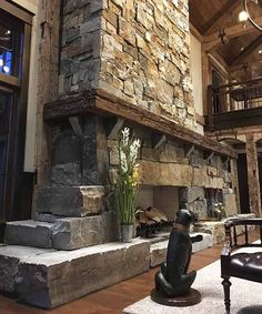 Dos and Don'ts of Rustic American Style Beautiful stone fireplace and reclaimed wood beam mantel<br> That traditional and historical mixed-materials look is tricky to nail down—here is a guide to doing it the right way. Cabin Fireplace, Rustic Fireplaces, Fireplace Design, Stone Fireplaces, Fireplace Mantles, Reclaimed Wood Mantel, Wood Mantels, Rustic Stone, Mountain Homes