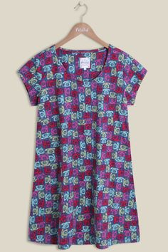 Sat on a blue base, the Telephone Whirly Tunic is packed with a multi-coloured telephone print. The array of vibrant colours offers a sense of fun while looking stylish with the scoop neckline and short sleeves. Pair up with our Betty Jeans or leggings for a casual look this season.