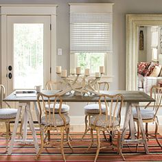 Note Window treatment under Window Molding 2010 Louisiana Idea House | Garage Apartment Dining Area | SouthernLiving.com