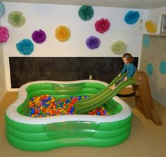 Ball pit kiddie pool and slide. Good idea to keep kids entertained in winter!