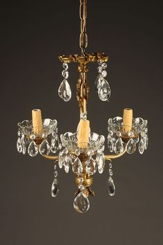 Antique French bronze and crystal 8 arm chandelier, circa 1900. Description from beauchampantiques.com. I searched for this on bing.com/images