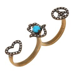 A ring with Love, blue turquoise stone in a Fatima hand and a Peace sign. For info contact www.the5almonds.com