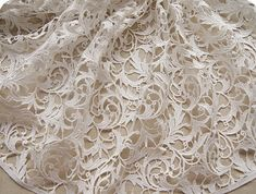 off White Lace Fabric Crocheted Embroidered Flowers door QFabrics