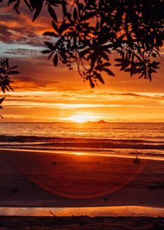 Dramatic rainy season sunset in Costa Rica. Photographed by Kristen M. Brown, Samba to the Sea for The Sunset Shop.