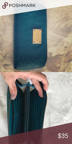 Authentic Micheal Kors -est 1981 wallet Color blue wallet... Excellent condition.. like New. Comes from a smoke free and pet free home. Michael Kors Bags Wallets
