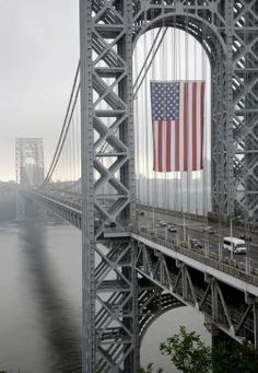 Absolutely beautiful photo of a massive American flag as it flies over NJ bridge for Labor Day - In Honor of Sept.11th....