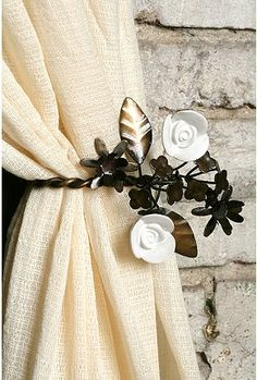 This cute curtain tie back reminds me of the wallpaper in my living room.
