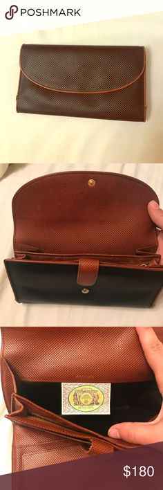 Authentic Bottega Veneta wallet Good used condition, authentic Bottega Veneta large checkbook wallet with zippered change compartment. Piping has some damage at the base on both sides, but otherwise excellent. Bottega Veneta Bags Wallets