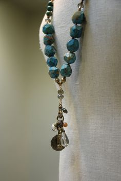 Wear it long...wear it lariated! This chunky turquoise charm necklace can be worn long or short. Handmade, one of a kind from Kathy Gaiser Jewels. Follow us on Facebook at: www.facebook.com/kathygaiserjewels