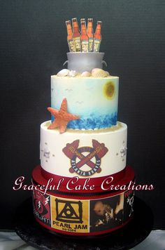 https://flic.kr/p/LCAum6 | Multi themed groom's cake | the bottom tier is decorated with Pearl Jam album covers the middle tier has the logos of the Atlanta Braves, N.Y. Rangers and the San Diego Chargers and the top tier has a beach theme with a bucket of iced Sweetwater Beer as the topper