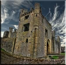 Middleham Castle is located in Wensleydale, in the county of North Yorkshire, in England.  The castle was built in 1270 on an earlier site from 1190.  The castle ruins are extensive, and although the roof no longer exists, most of the walls are intact.  The castle is rectangular in design and consists of a massive Norman keep surrounded by a later curtain wall.  There are turrets in each corner and a midway along each wall.