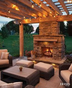 """After they saw a spectacular outdoor fire place at a neighbor's home, this family knew they had to have Land Design Group (LDG) design and install one in their Overland Park backyard. """"The homeowners love to crackle the fire and wanted a wood burning fireplace and dining area, along with a pergola,"""" noted Chris Feldkamp, owner of LDG, whose team went to work on constructing this fully custom-made rugged yet stylish design that encourages lots of family time for nearly year-round usage."""