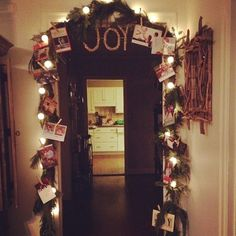 Christmas card garland with glittered clothes pins - I always keep my cards and wonder what to do with them.  Now I know! #GlitterClothes