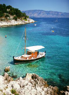 Docked Boat on Kalamaki Beach in Corfu Greece | photography by http://www.lovenotephotography.com/