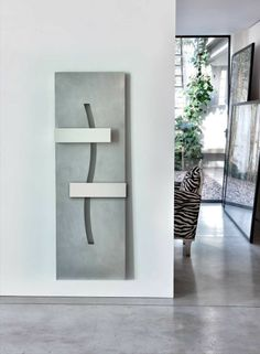 ABSTRACT-09 design ridea Few elements generate lots of symbols: the essentiality is a powerful communication mean, it leaves space to the imagination that fills up the shapes with other meanings and it invents every day a new thought.  #home #radiator #design #aluminum #interiordesign #forniture