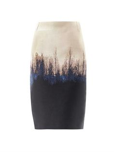 A high-waisted knee-length skirt with a champagne-beige, black and blue tree silhouette jacquard detailing. The slim fitting skirt has a hidden zip side fastening.