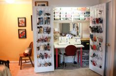 A well-described example of an organized sewing room contained in a coat closet.