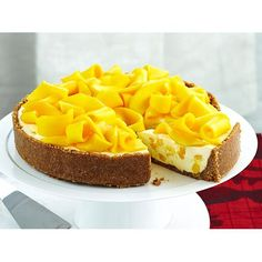 Mango macadamia cheesecake recipe - By Woman's Day, Fresh, ripe mango is food of the gods no matter what dish it finds its way into. Included in this creamy cheesecake with a biscuit, coconut and macadamia base, it makes a positively heavenly dessert.