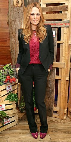 MOLLY SIMS Speaking of appetites, Molly hosts the debut of Wendy's new salad collection in N.Y.C. wearing a black suit with a cherry-hued lace top from Diane von Furstenberg.