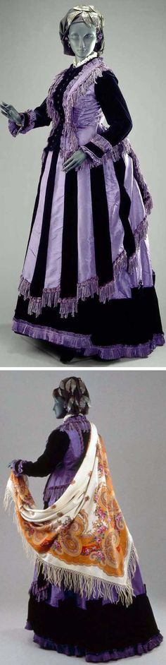 Day dress, American, ca. 1870. Three pieces. Purple silk taffeta and black velvet. Bodice trimmed with purple fringe and black buttons; long sleeves. Skirt hem of black velvet trimmed with purple ruchings. Overskirt or apron of alternate stripes of black velvet and purple taffeta; trimmed with purple fringe and self-ruchings. Museum of Fine Arts, Boston