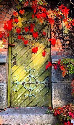 Beautiful green arched door in Oslo, Norway.
