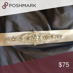 Bridal belt Crystal, never worn! Adds the perfect amount of sparkle to any dress! It's a candlelight/soft white color Dresses Wedding